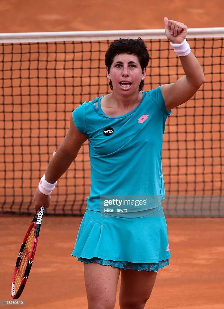 <a gi-track='captionPersonalityLinkClicked' href=/galleries/search?phrase=Carla+Suarez+Navarro&family=editorial&specificpeople=5294252 ng-click='$event.stopPropagation()'>Carla Suarez Navarro</a> of Spain celebrates victory in her Women's Semi Final against Simona Halep of Romania on Day Seven of The Internazionali BNL d'Italia 2015 at the Foro Italico on May 16, 2015 in Rome, Italy.