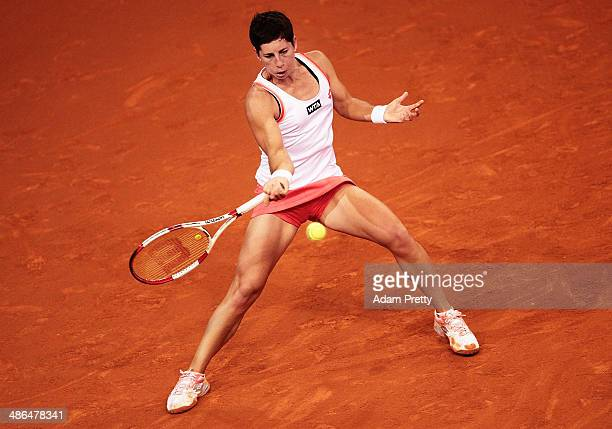 Carla Suarez Navarro of Spain hits a forehand during her match against Angelique Kerber of Germany on day four of the Porsche Tennis Grand Prix 2014...