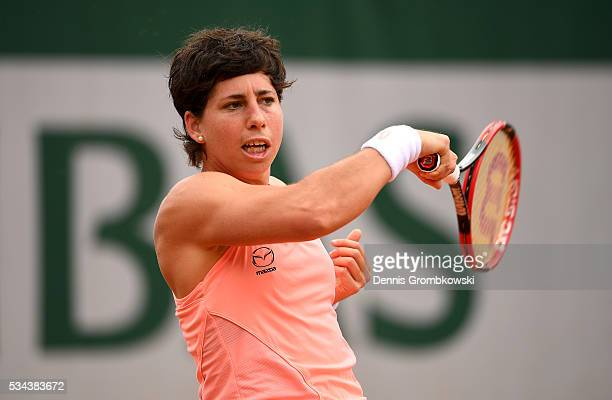 Carla Suarez Navarro of Spain hits a forehand during the Ladies Singles second round match against Qiang Wang of China on day five of the 2016 French...