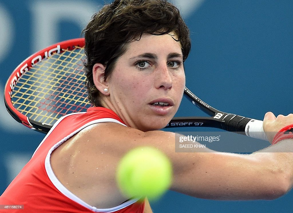 <a gi-track='captionPersonalityLinkClicked' href=/galleries/search?phrase=Carla+Suarez+Navarro&family=editorial&specificpeople=5294252 ng-click='$event.stopPropagation()'>Carla Suarez Navarro</a> of Spain hits a return against Maria Sharapova of Russia in their women's singles quarter-final match at the Brisbane International tennis tournament in Brisbane on January 8, 2015. AFP PHOTO / Saeed KHAN USE