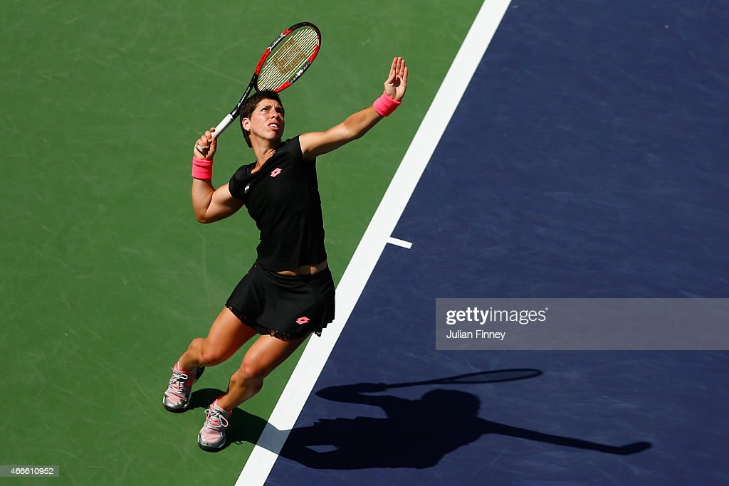 <a gi-track='captionPersonalityLinkClicked' href=/galleries/search?phrase=Carla+Suarez+Navarro&family=editorial&specificpeople=5294252 ng-click='$event.stopPropagation()'>Carla Suarez Navarro</a> of Spain in action against Heather Watson of Great Britain during day nine of the BNP Paribas Open tennis at the Indian Wells Tennis Garden on March 17, 2015 in Indian Wells, California.