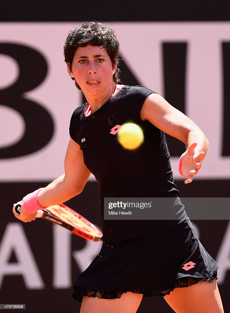 <a gi-track='captionPersonalityLinkClicked' href=/galleries/search?phrase=Carla+Suarez+Navarro&family=editorial&specificpeople=5294252 ng-click='$event.stopPropagation()'>Carla Suarez Navarro</a> of Spain in action against Maria Sharapova of Russia in the Women's Singles Final on Day Eight of The Internazionali BNL d'Italia 2015 at the Foro Italico on May 17, 2015 in Rome, Italy.
