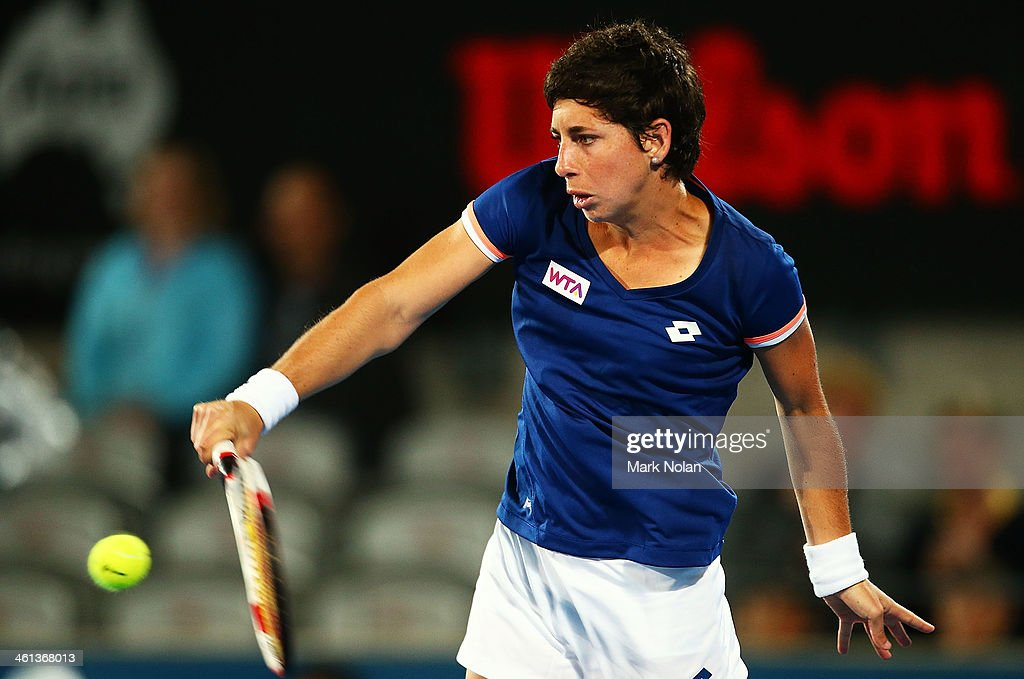 Carla Suarez Navarro of Spain plays a backhand in her match against Angelique Kerber of Germany during day four of the 2014 Sydney International at Sydney Olympic Park Tennis Centre on January 8, 2014 in Sydney, Australia.