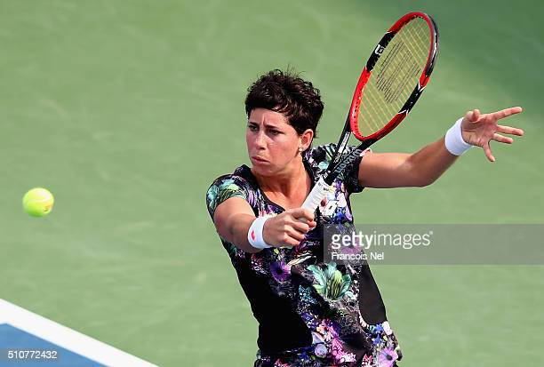 Carla Suarez Navarro of Spain plays a backhand in her match against Caroline Garcia of France during day three of the WTA Dubai Duty Free Tennis...
