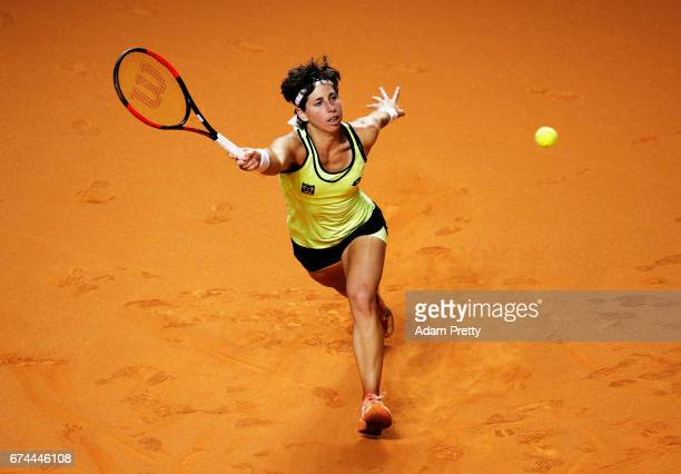 Carla Suarez Navarro of Spain plays a forehand during her match against Kristina Mladenovic of France during the Porsche Tennis Grand Prix at Porsche...