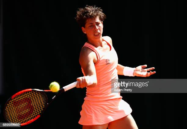 Carla Suarez Navarro of Spain plays a forehand during the ladies singles first round match against Maria Sakkari of Greece on day three of the 2017...