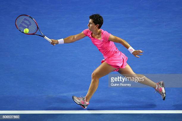 Carla Suarez Navarro of Spain plays a forehand in her fourth round match against Daria Gavrilova of Australia during day seven of the 2016 Australian...