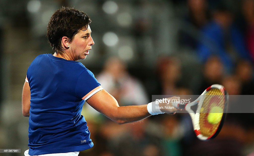 Carla Suarez Navarro of Spain plays a forehand in her match against Angelique Kerber of Germany during day four of the 2014 Sydney International at Sydney Olympic Park Tennis Centre on January 8, 2014 in Sydney, Australia.