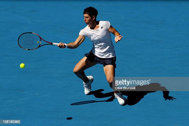 Carla Suarez Navarro of Spain plays a forehand in her second round match against Kim Clijsters of Belgium during day four of the 2011 Australian Open...