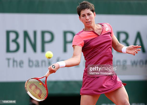 Carla Suarez Navarro of Spain plays a forehand in her Women's Singles match against Sara of Italy during day eight of the French Open at Roland...