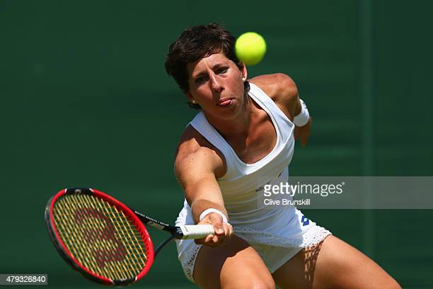 Carla Suarez Navarro of Spain plays a forehand in his Ladies Singles Third Round match against Garbine Muguruza of Spain during day five of the...