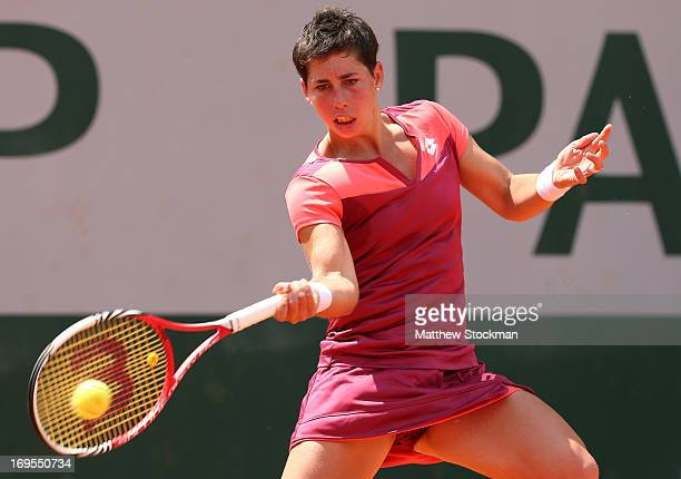 Carla Suarez Navarro of Spain plays a forehand in his Women's Singles match against Simona Halep of Romania during day two of the French Open at...