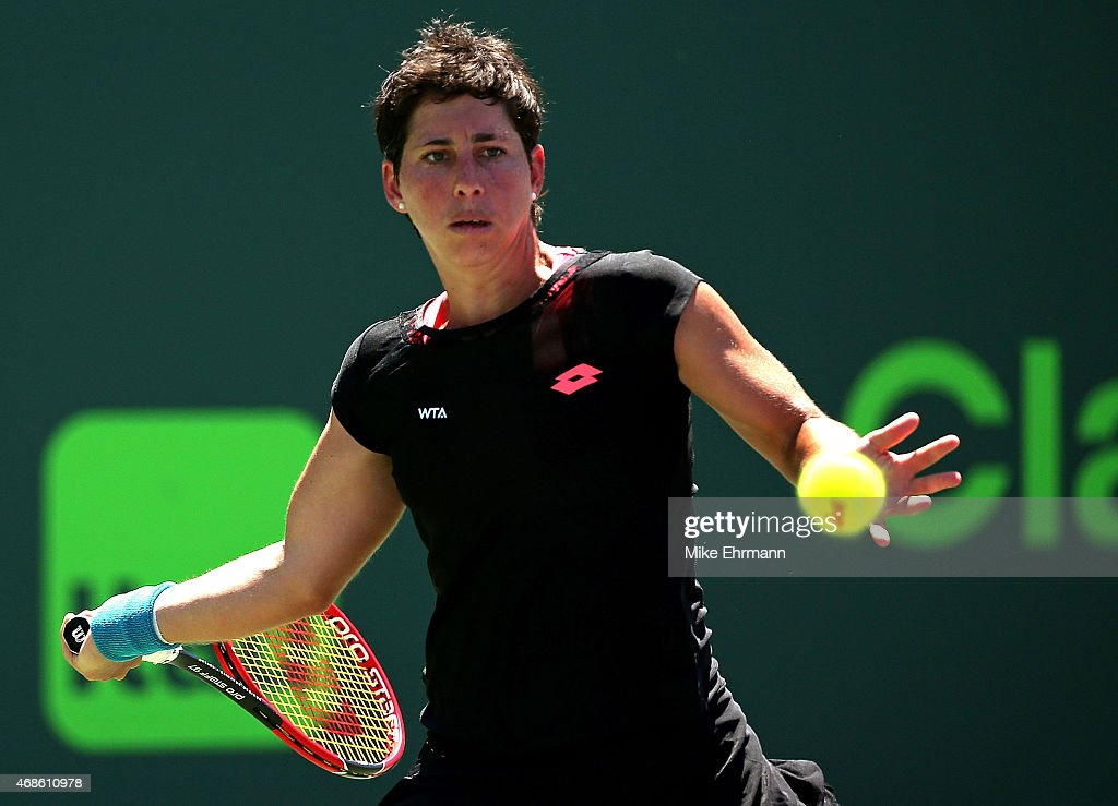 <a gi-track='captionPersonalityLinkClicked' href=/galleries/search?phrase=Carla+Suarez+Navarro&family=editorial&specificpeople=5294252 ng-click='$event.stopPropagation()'>Carla Suarez Navarro</a> of Spain plays in the Women's Final of the Miami Open presented by Itau against Serena Williams during Day 13 at Crandon Park Tennis Center on April 4, 2015 in Key Biscayne, Florida.