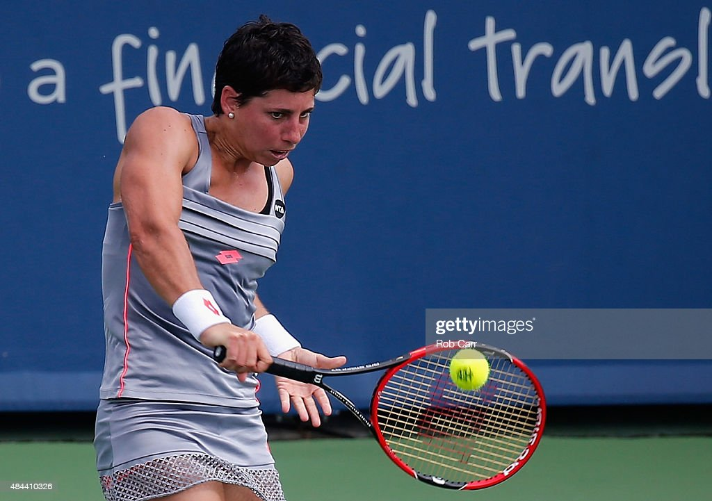 <a gi-track='captionPersonalityLinkClicked' href=/galleries/search?phrase=Carla+Suarez+Navarro&family=editorial&specificpeople=5294252 ng-click='$event.stopPropagation()'>Carla Suarez Navarro</a> of Spain returns a shot to Sloane Stephens during Day 4 of the Western & Southern Open at the Linder Family Tennis Center on August 18, 2015 in Cincinnati, Ohio.