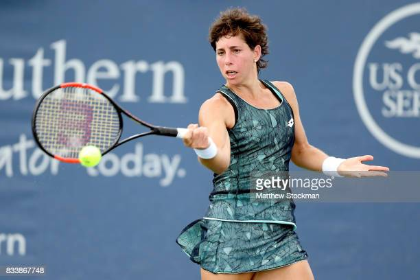 Carla Suarez Navarro of Spain returns a shot to Svetlana Kuznetsova of Russia during day 6 of the Western Southern Open at the Lindner Family Tennis...