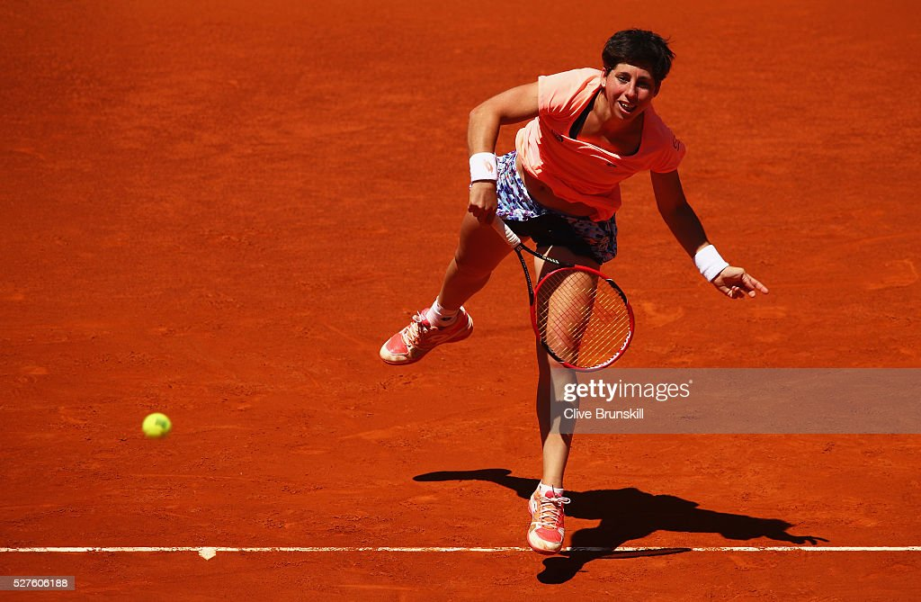 <a gi-track='captionPersonalityLinkClicked' href=/galleries/search?phrase=Carla+Suarez+Navarro&family=editorial&specificpeople=5294252 ng-click='$event.stopPropagation()'>Carla Suarez Navarro</a> of Spain serves against Sabine Lisicki of Germany in their second round match during day four of the Mutua Madrid Open tennis tournament at the Caja Magica on May 03, 2016 in Madrid,Spain.