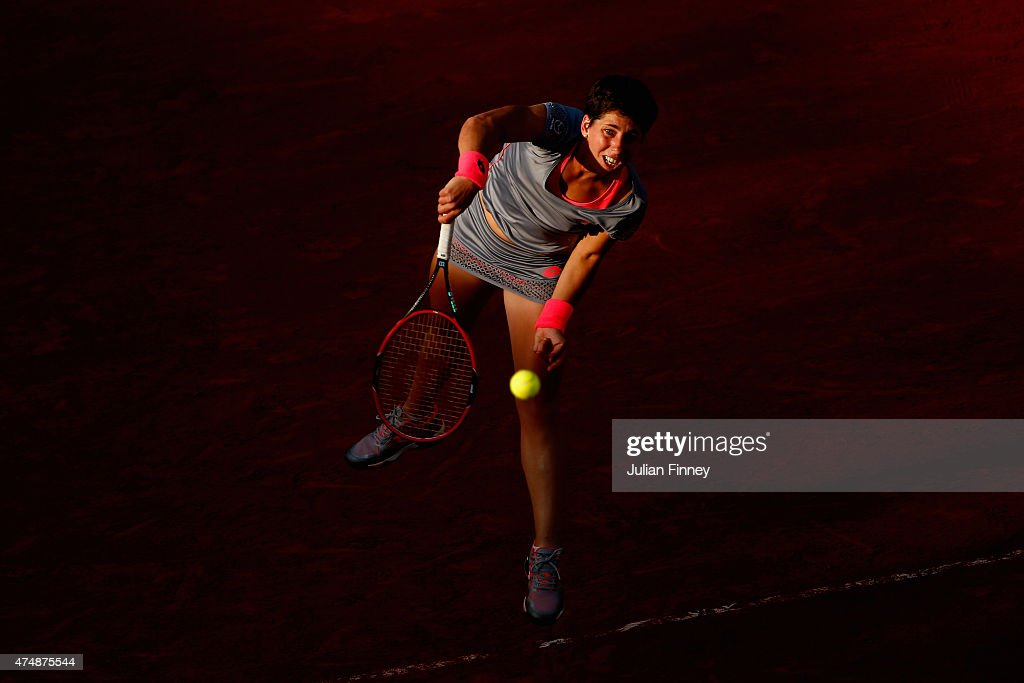 <a gi-track='captionPersonalityLinkClicked' href=/galleries/search?phrase=Carla+Suarez+Navarro&family=editorial&specificpeople=5294252 ng-click='$event.stopPropagation()'>Carla Suarez Navarro</a> of Spain serves during her women's singles match against Virginie Razzano of France during day four of the 2015 French Open at Roland Garros on May 27, 2015 in Paris, France.