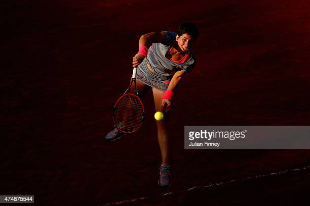 Carla Suarez Navarro of Spain serves during her women's singles match against Virginie Razzano of France during day four of the 2015 French Open at...
