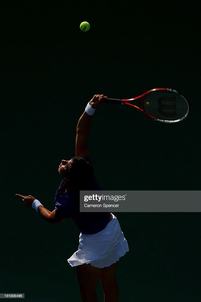 <a gi-track='captionPersonalityLinkClicked' href=/galleries/search?phrase=Carla+Suarez+Navarro&family=editorial&specificpeople=5294252 ng-click='$event.stopPropagation()'>Carla Suarez Navarro</a> of Spain serves during her women's singles second round match against Agnieszka Radwanska of Poland on Day Four of the 2012 US Open at USTA Billie Jean King National Tennis Center on August 30, 2012 in the Flushing neigborhood of the Queens borough of New York City.