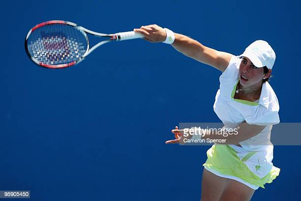 Carla Suarez Navarro of Spain serves in her second round match against Andrea Petkovic of Germany during day four of the 2010 Australian Open at...