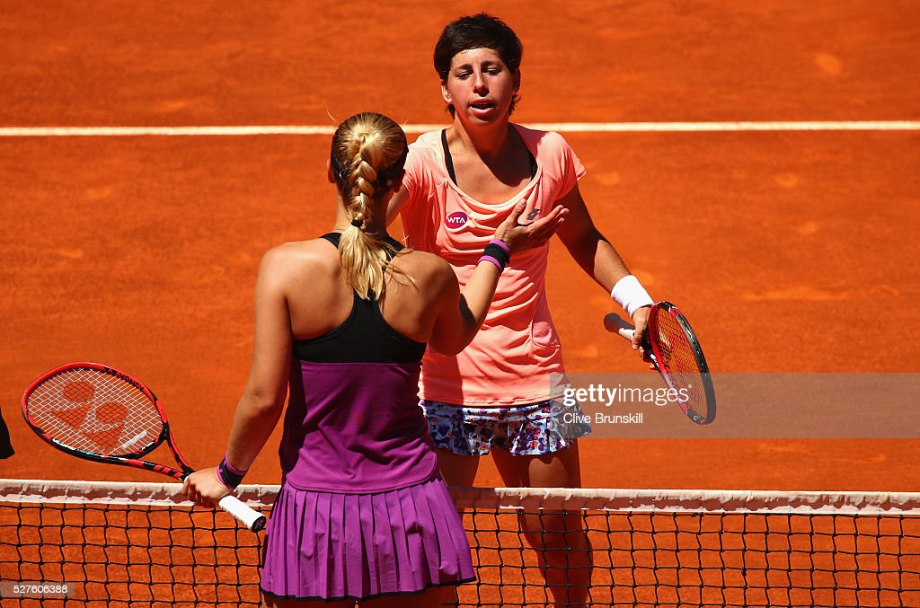 <a gi-track='captionPersonalityLinkClicked' href=/galleries/search?phrase=Carla+Suarez+Navarro&family=editorial&specificpeople=5294252 ng-click='$event.stopPropagation()'>Carla Suarez Navarro</a> of Spain shakes hands at the net after her straight sets victory against <a gi-track='captionPersonalityLinkClicked' href=/galleries/search?phrase=Sabine+Lisicki&family=editorial&specificpeople=645395 ng-click='$event.stopPropagation()'>Sabine Lisicki</a> of Germany in their second round match during day four of the Mutua Madrid Open tennis tournament at the Caja Magica on May 03, 2016 in Madrid,Spain.