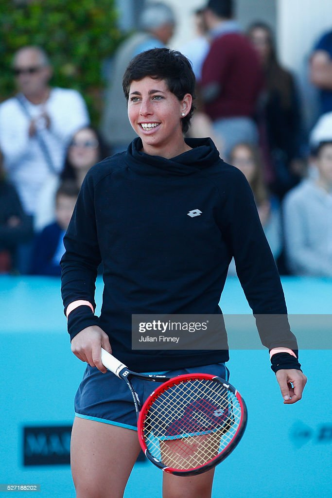 <a gi-track='captionPersonalityLinkClicked' href=/galleries/search?phrase=Carla+Suarez+Navarro&family=editorial&specificpeople=5294252 ng-click='$event.stopPropagation()'>Carla Suarez Navarro</a> of Spain smiles as she hits with sponsors during day three of the Mutua Madrid Open tennis tournament at the Caja Magica on May 02, 2016 in Madrid, Spain.