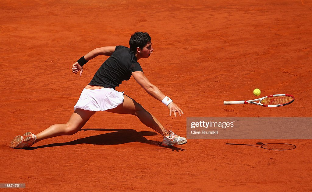 <a gi-track='captionPersonalityLinkClicked' href=/galleries/search?phrase=Carla+Suarez+Navarro&family=editorial&specificpeople=5294252 ng-click='$event.stopPropagation()'>Carla Suarez Navarro</a> of Spain throws her racket at the ball after failing to reach a backhand against Serena Williams of the United States in their third round match during day six of the Mutua Madrid Open tennis tournament at the Caja Magica on May 8, 2014 in Madrid, Spain.