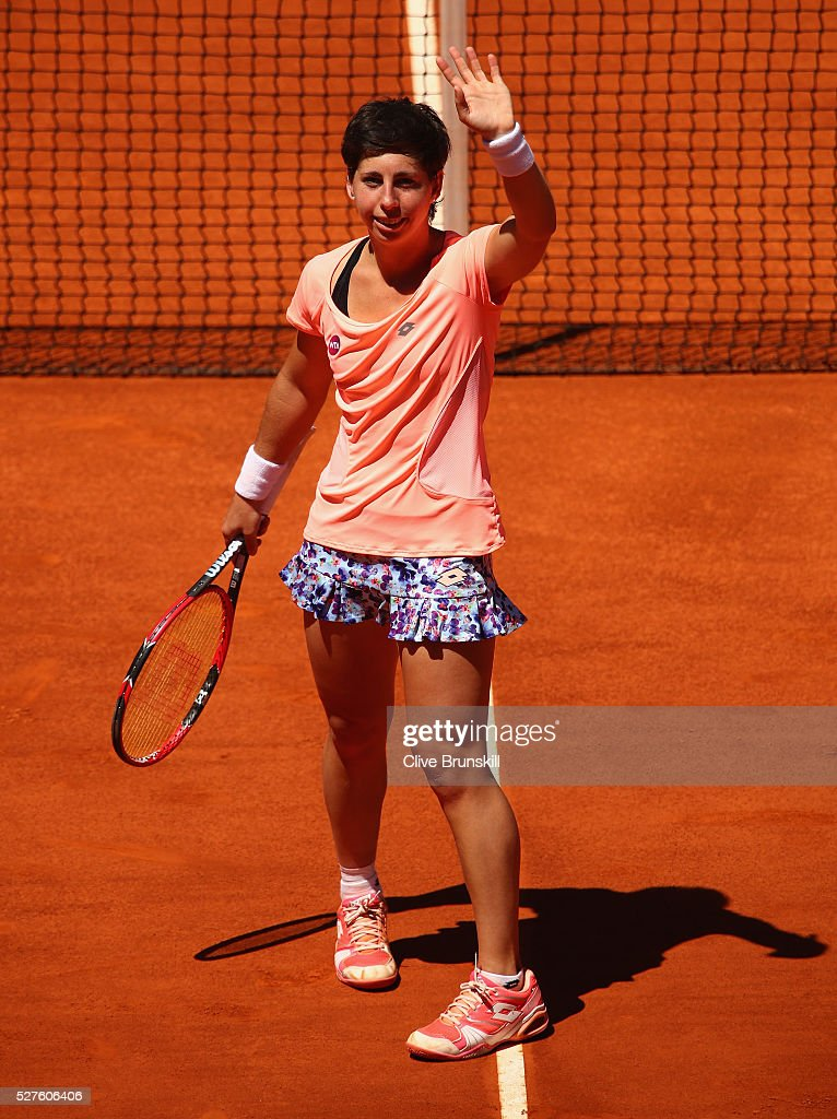 <a gi-track='captionPersonalityLinkClicked' href=/galleries/search?phrase=Carla+Suarez+Navarro&family=editorial&specificpeople=5294252 ng-click='$event.stopPropagation()'>Carla Suarez Navarro</a> of Spain waves to the crowd after her straight sets victory against Sabine Lisicki of Germany in their second round match during day four of the Mutua Madrid Open tennis tournament at the Caja Magica on May 03, 2016 in Madrid,Spain.
