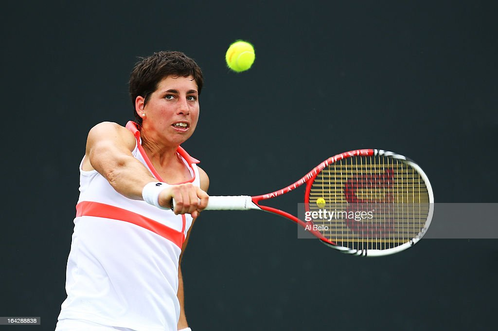 Carla Suarez Navarro Spain returns a shot to Jamie Hampton of the USA during day 5 of the Sony Open at the Crandon Park Tennis Center on March 22, 2013 in Key Biscayne, Florida.