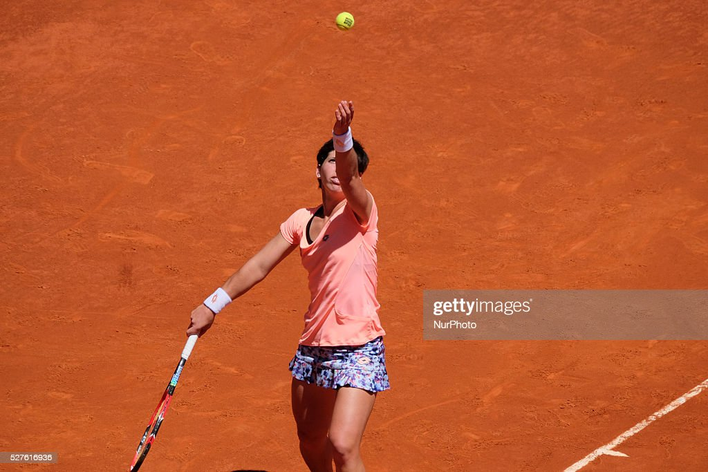 Carla Suarez of Spain in action Sabine Lisicki of Germany their match during day fourth of the Mutua Madrid Open tennis tournament at the Caja Magica on May 03 2016 in Madrid,Spain.