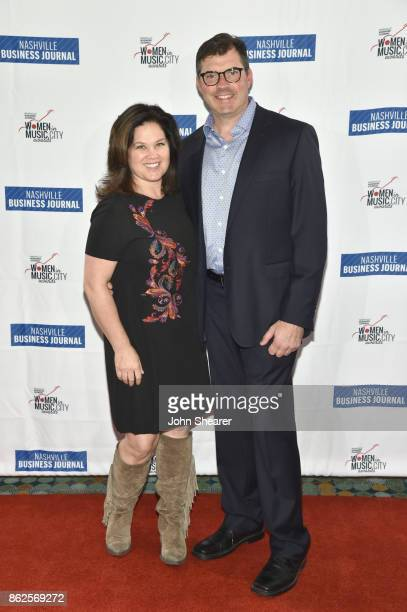 Carla Wallace of Big Yellow Dog Music and guest arrive at the 2017 Nashville Business Journal Women In Music City on October 17 2017 in Nashville...