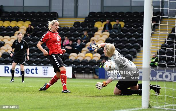 Carla Ward of Sheffield FC Ladies scoring their first goal past Sophie Dando of Cardiff City Ladies during the FA Women's Premier League Cup Final...