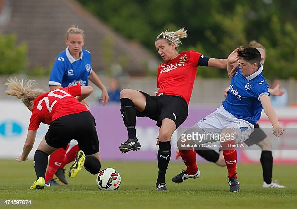 Carla Ward of Sheffield holds up the ball ahead of Eilidh Curry of Portsmouth during the The WPL Playoff Final between Portsmouth FC Ladies and...