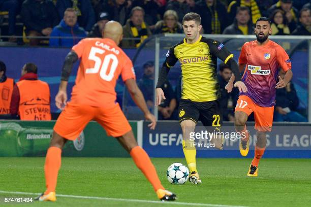 Carlao of Nikosia Christian Pulisic of Dortmund and Ghayas Zahid of Nikosia battle for the ball during the UEFA Champions League Group H soccer match...