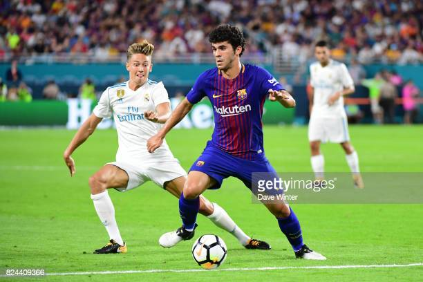 Carles Alena of Barcelona and Lucas Vazquez of Real Madrid during the International Champions Cup match between Barcelona and Real Madrid at Hard...