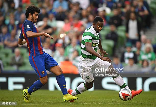 Carles Alena of Barcelona and Moussa Dembele of Celtic during the International Champions Cup series match between Barcelona and Celtic at Aviva...