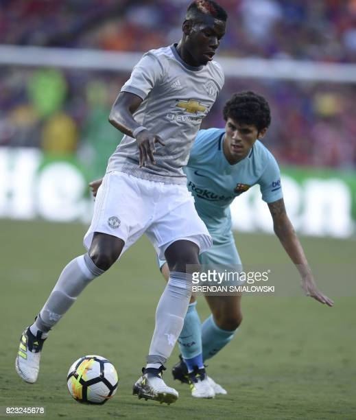 Carles Alena of Barcelona and Paul Pogba of Manchester United fight for the ball during their International Champions Cup football match on July 26...
