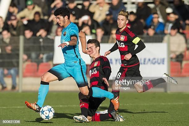 Carles Alena of FC Barcelona U19 David Putz of Bayer 04 Leverkusen U19 Marlon Frey of Bayer 04 Leverkusen U19 during the UEFA Youth League match...
