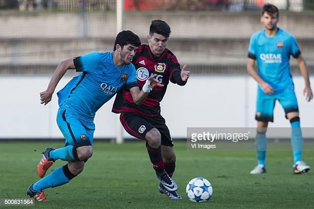 Carles Alena of FC Barcelona U19 Patrik Dzalto of Bayer 04 Leverkusen U19 during the UEFA Youth League match between Bayer 04 Leverkusen U19 and...