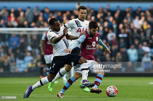 Carles Gil of Aston Villa battles with Danny Rose of Tottenham Hotspur during the Barclays Premier League match between Aston Villa and Tottenham...
