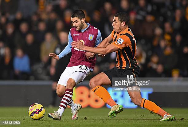 Carles Gil of Aston Villa is challenged by Jake Livermore of Hull City during the Barclays Premier League match between Hull City and Aston Villa at...