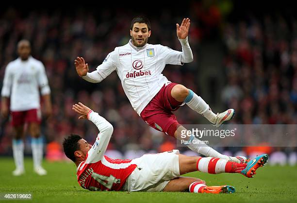 Carles Gil of Aston Villa is tackled by Francis Coquelin of Arsenal during the Barclays Premier League match between Arsenal and Aston Villa at the...