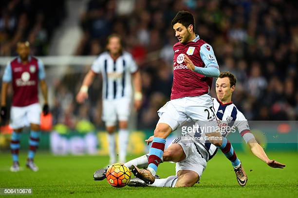 Carles Gil of Aston Villa is tackled by Jonny Evans of West Bromwich Albion during the Barclays Premier League match between West Bromwich Albion and...