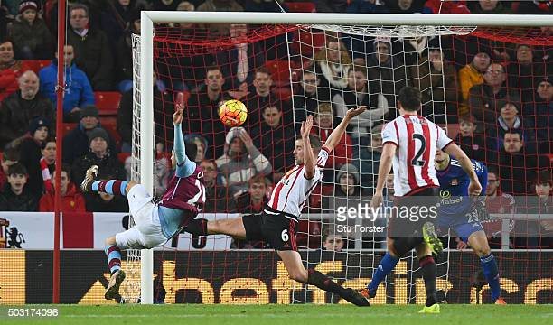 Carles Gil of Aston Villa scores his team's first goal during the Barclays Premier League match between Sunderland and Aston Villa at Stadium of...