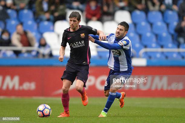 Carles Gil of RC Deportivo La Coruna competes for the ball with Sergi Roberto of FC Barcelona during the La Liga match between RC Deportivo La Coruna...