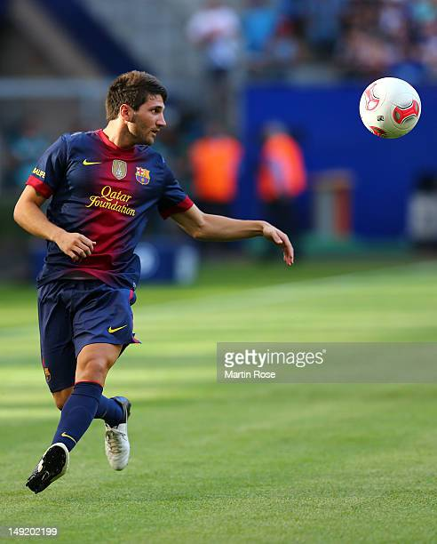 Carles Planas of Barcelona runs with the ball during the friendly match between Hamburger SV and FC barcelona at Imtech Arena on July 24 2012 in...
