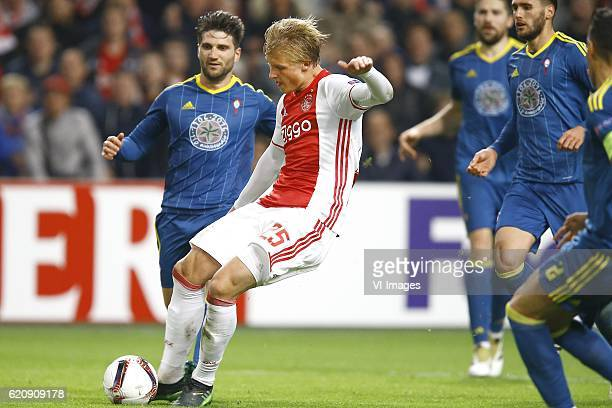 Carles Planas of Celta de Vigo Kasper Dolberg of Ajax Amsterdam scoresduring the UEFA Europa League group G match between Ajax Amsterdam and Celta de...