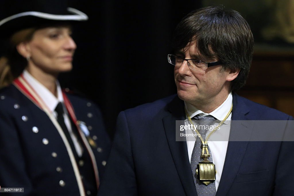 Carles Puigdemont, Catalonia's incoming president, smiles after he is sworn into office at the Palau de la Generalitat in Barcelona, Spain, on Tuesday, Jan. 12, 2016. The former mayor of Girona, a city near Spain's border with France, emerged as a last-minute compromise candidate as the fighting between two factions within the independence movement threatened to force new elections, jeopardizing their majority in the regional assembly. Photographer: Pau Barrena/Bloomberg via Getty Images