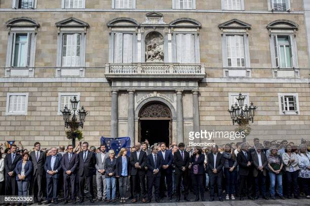 Carles Puigdemont Catalonia's president and other government officials take part in a silent demonstration outside the Generalitat in support of...