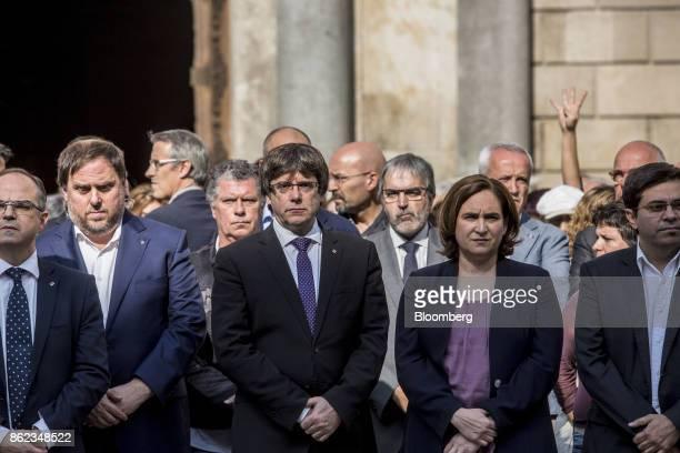 Carles Puigdemont Catalonia's president center Ada Colau mayor of Barcelona center right Jordi Turell Catalan government spokesman left and Oriol...
